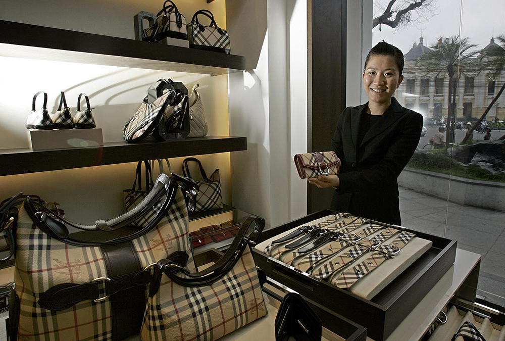 2706ea0fc086 A salesperson shows a purse at a Burberry store in Hanoi